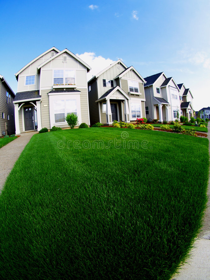 Houses and lawn. A housing development behind a nice lawn stock images