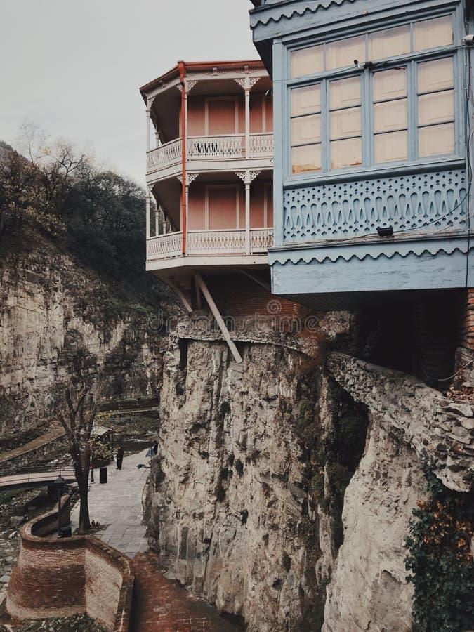 Houses of legvtakhevi in Tbilisi. Legvtakhevi canyon with old bridge in Tbilisi, Georgia royalty free stock images