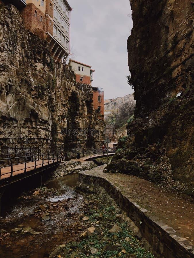 Houses of legvtakhevi in Tbilisi. Legvtakhevi canyon with old bridge in Tbilisi, Georgia royalty free stock photography