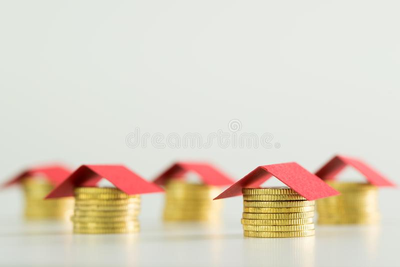 Houses made from coins and red color roof stock image
