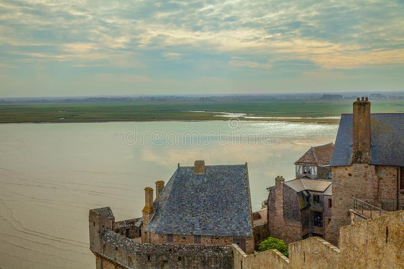 Houses on Mont Saint Michel France. Houses overlooking sea and marshland at Mont Saint Michel Normandy France royalty free stock photo