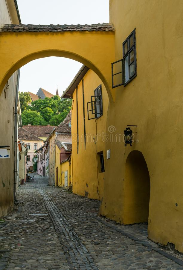 Houses on the narrow streets of the medieval town Sighisoara, Romania. Ancient buildings and street cafes stock images