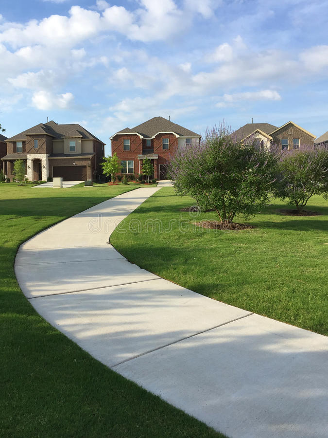 Houses and park design in friendly community stock photos
