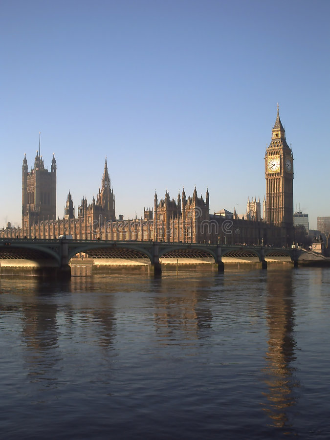 Houses of parliament. In london reflected in the river thames stock photos