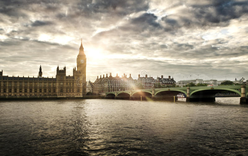 Houses of Parliament and Big Ben, London. Houses of Parliament and Westminster bridge on a cloudy day royalty free stock photos