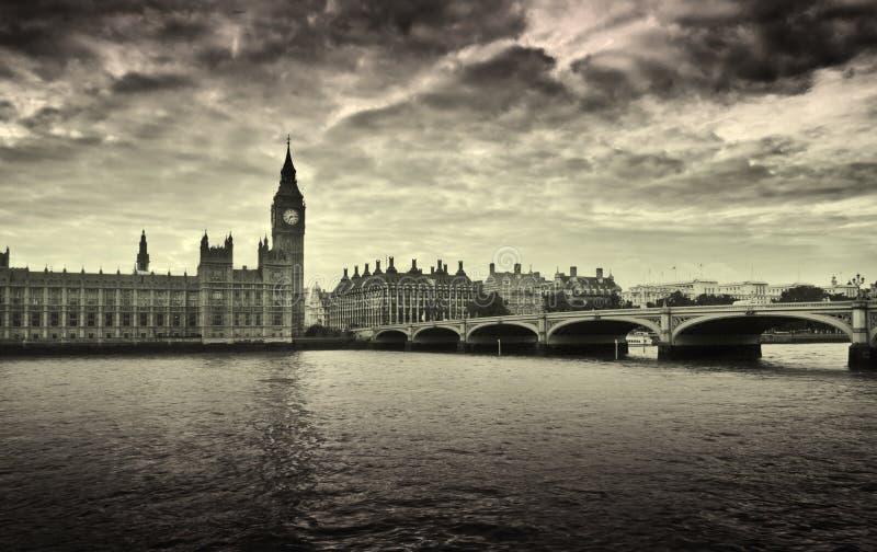 Houses of Parliament and Big Ben, London. Gloomy and dark image of Houses of Parliament and Westminster bridge royalty free stock image