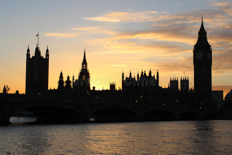 Houses of Parliament and Big Ben London at sunset. View across the River Thames at sunset looking towards the silhouette of the Houses of Parliament and Big Ben stock photo