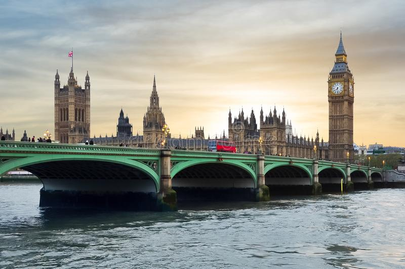 Houses of Parliament, Big Ben and Westminster bridge at sunset, London, United Kingdom stock photos