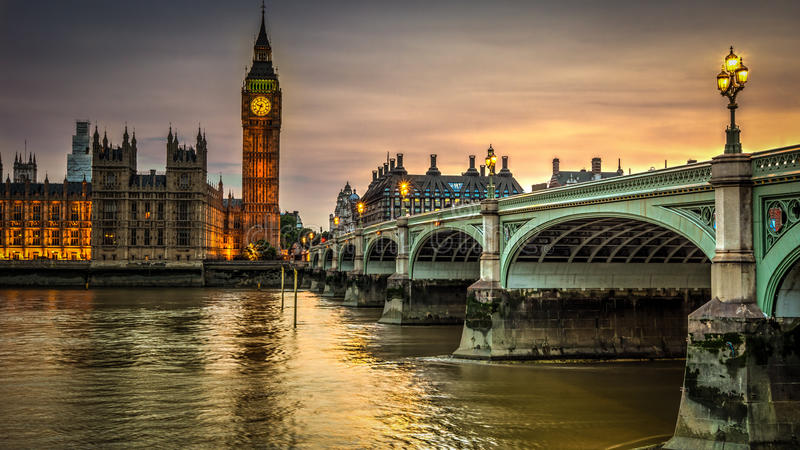 Houses of Parliament at sunset. Houses of Parliament and Big Ben beside the River Thames and Westminster Bridge, London, at sunset stock photos