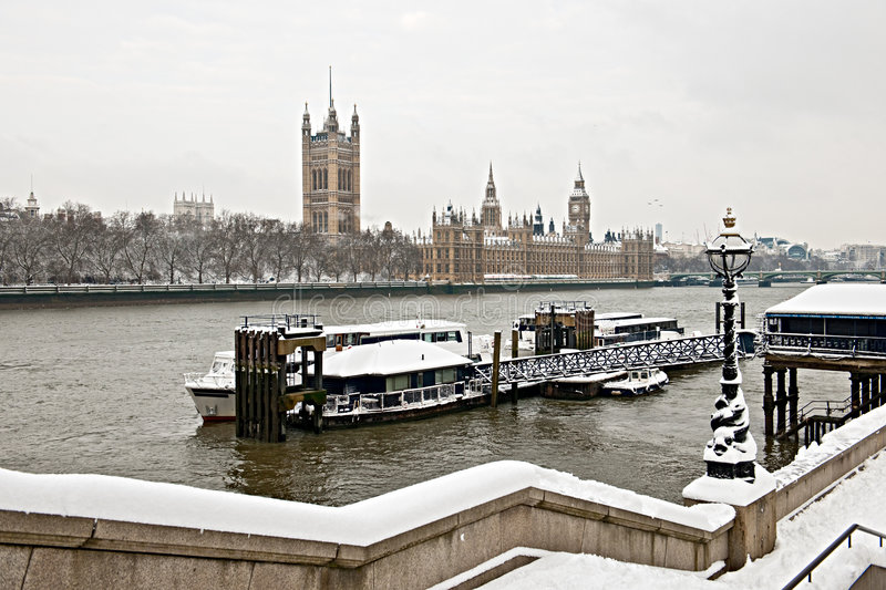 Houses Of Parliament, Thames, London In The Snow Royalty Free Stock Image