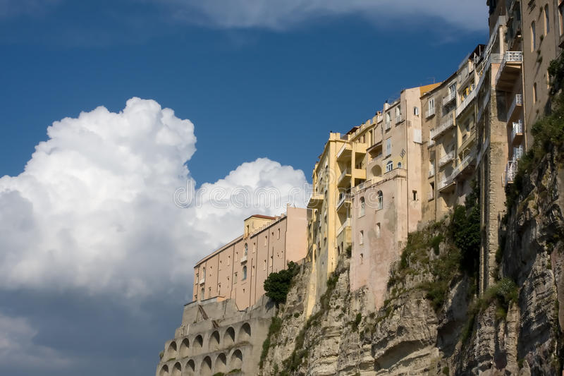 Houses on rocks in the clouds stock images