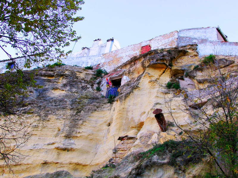 Houses on the rocks of the mountain in the village of Chiclana de Segura stock photos