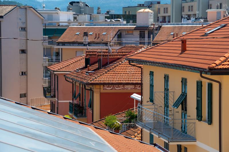 Houses with roofs covered with orange roof tiles. Italian street. royalty free stock photo