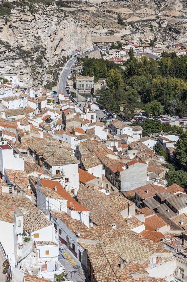 Houses and roofs next to mountain limestone, view to the mountains of the river Jucar, take in Alcala of the Jucar, Albacete prov. Alcala del Jucar, Spain royalty free stock photography