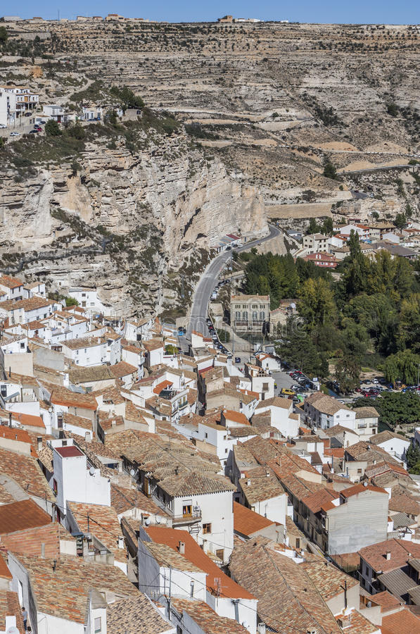 Houses and roofs next to mountain limestone, view to the mountains of the river Jucar, take in Alcala of the Jucar, Albacete prov. Alcala del Jucar, Spain royalty free stock image