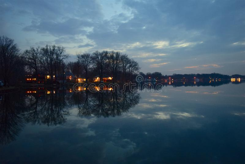 Houses by shore of lake royalty free stock photo