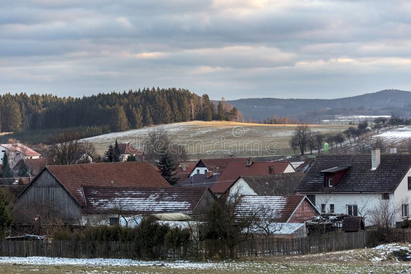 Houses of small villages under the slopes enlightened by the setting sun. At the beginning of the winter royalty free stock photo
