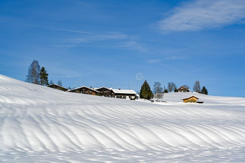 Farm houses in snow covered landscape of Bavaria, Germany stock photography