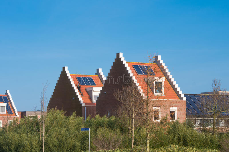 Houses with solar panels stock photography