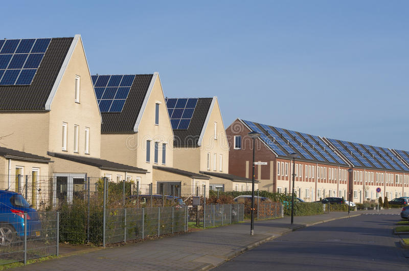 Houses with solar panels stock photos