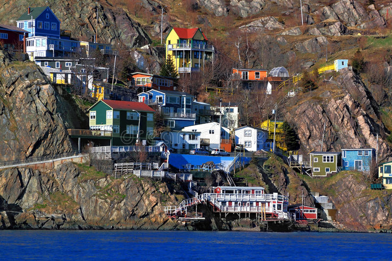 Houses of St.Johns Newfoundland. Canada situated over the footsteps of Signal Hill in the beginning of ?The Narrows? ? natural channel which protect the Harbor royalty free stock image