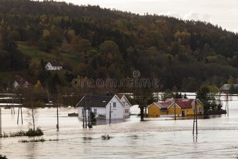 Houses standing in the deep water at Drangsholt. Flooding from the river Tovdalselva in Kristiansand, Norway - October 3 royalty free stock image