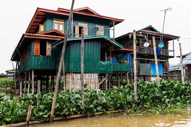 Houses on stilts in Inle lake. Myanmar - Burma - Birmania. Houses on stilts in Inle lake.The stilts must be high, as the lake level fluctuates severe between the royalty free stock photos