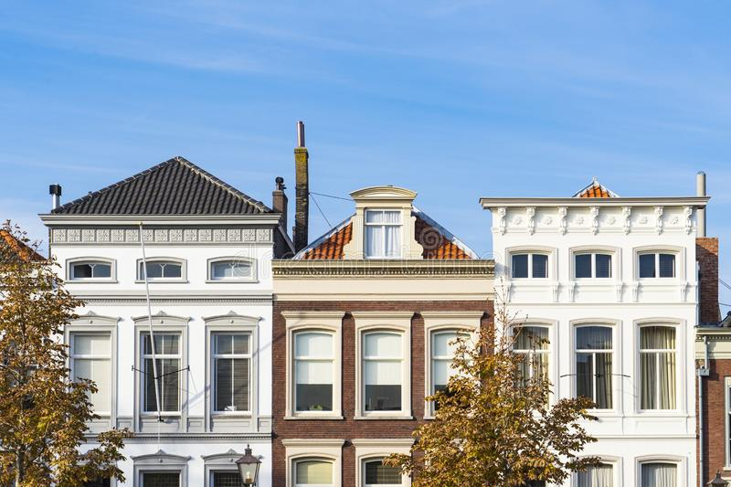 Houses in street called Wolwevershaven, Dordrecht, The Netherlands. Detail of apartments in street called Wolwevershaven, Dordrecht, The Netherlands. Blue sky stock photography