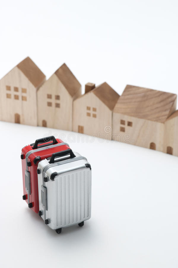 Houses and suitcases on white background. stock image