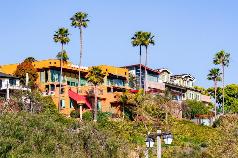 Houses up on a hill on a residential part of San Diego, California stock photos