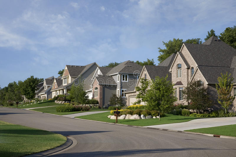 Download Houses On Upscale Suburban Street In Morning Sunlight Stock Photography - Image: 31595392