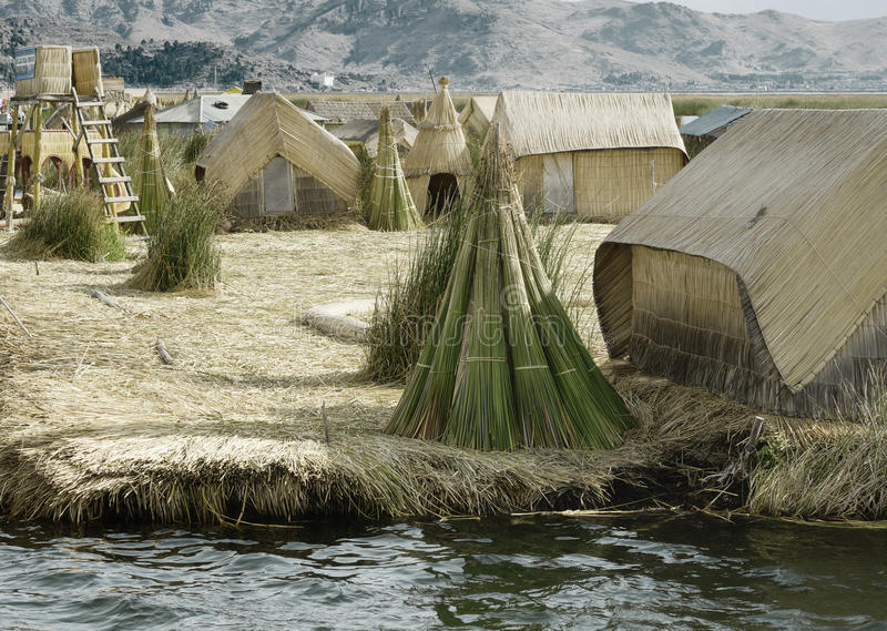 Houses on the Uros Floating Islands made of tortora rushes stock photos