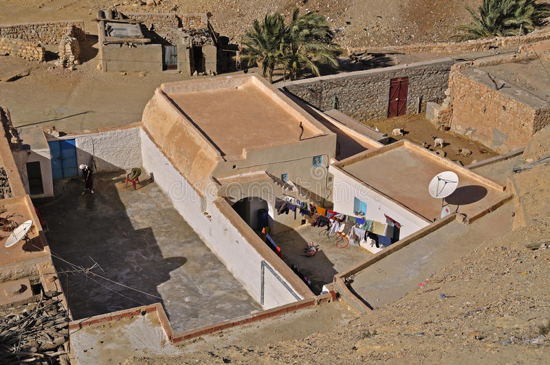 Houses in a village in the desert. Houses and courtyards in the village, desert stone, eastern Sahara, Chenini village, southern Tunisia royalty free stock photography