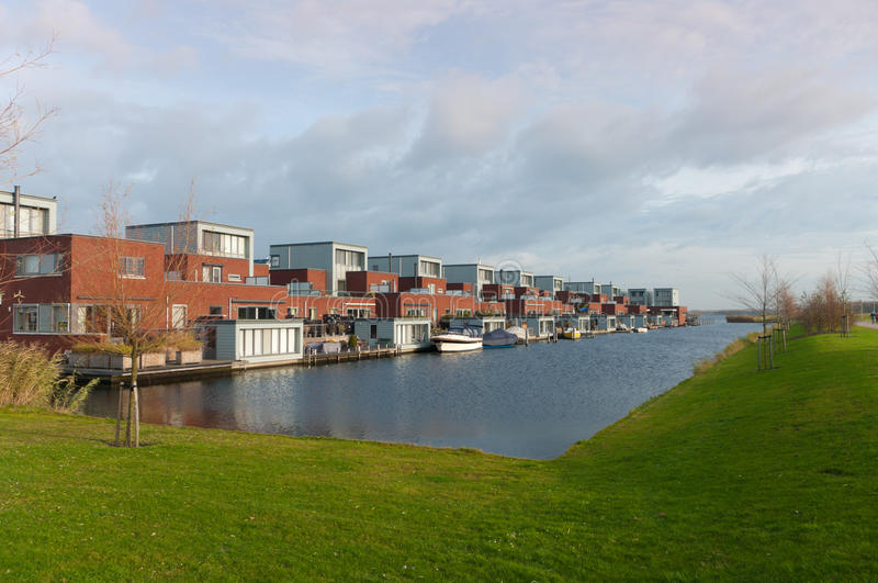 Houses at the water. Residential area in Almere, Netherlands, built on an artificial island royalty free stock photos