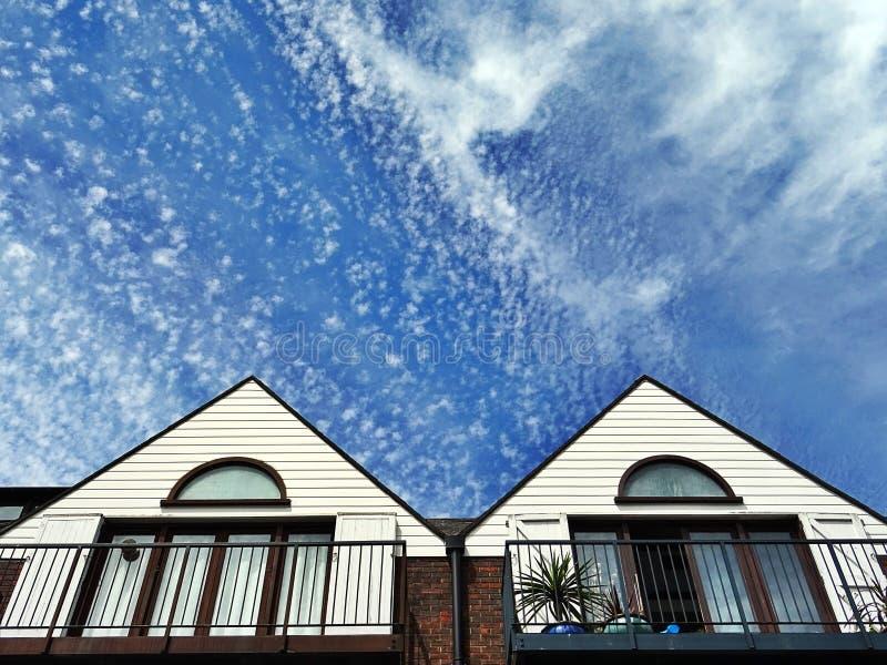 Housetops and sky stock image