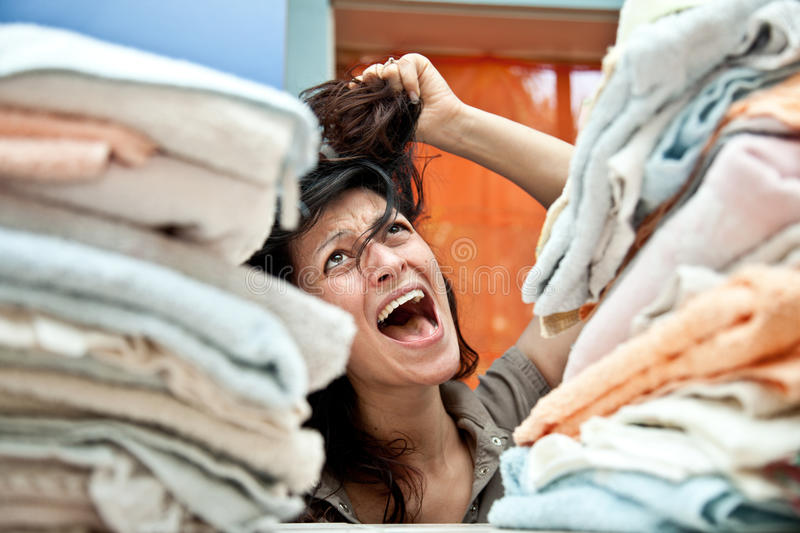 Housewife. Desperate housewife and overwhelmed by too many chores stock photos