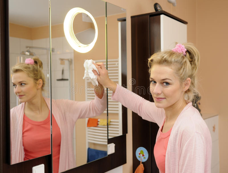 Download Housewife cleans a mirror stock photo. Image of blond - 17820618
