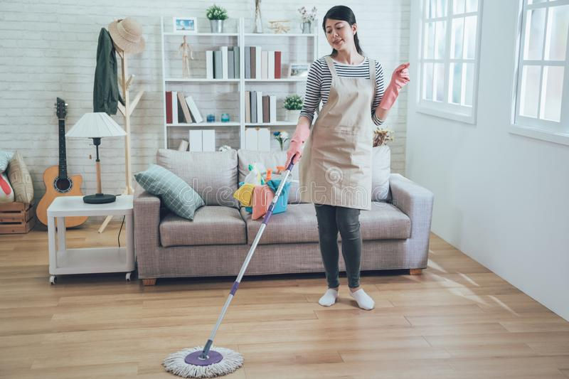 Housewife clicking her finger doing housework royalty free stock images