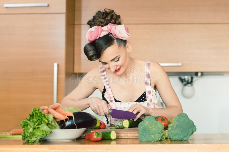 Housewife and cook cutting vegetables at home in the kitchen. Making a salad royalty free stock photos