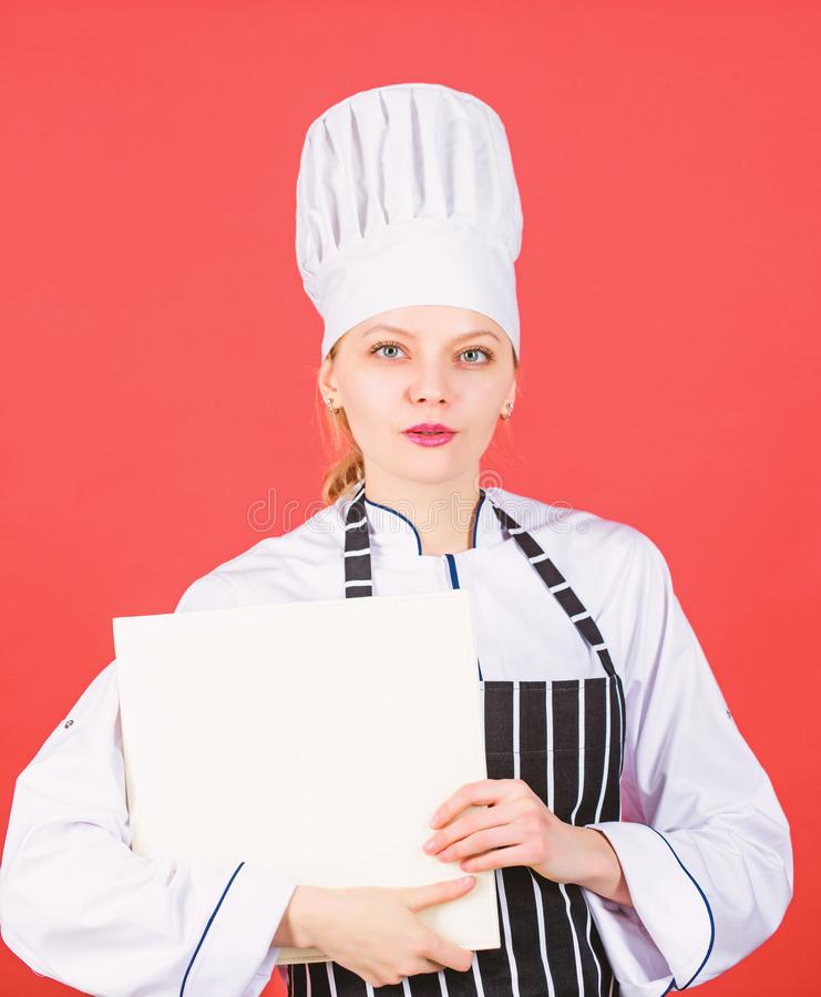 Housewife with cookery book. restaurant menu. Culinary dieting. woman in cook hat and apron. professional chef in stock photography