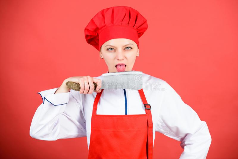 Housewife with cooking knife. butcher cut meat. woman in cook hat and apron. professional chef in kitchen. Cuisine stock photo