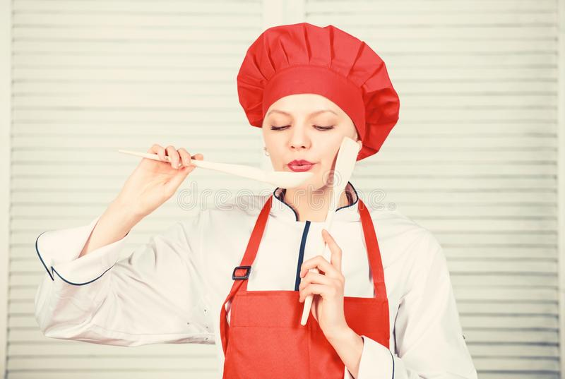 Housewife with cooking utensil. woman in cook hat and apron. professional chef in kitchen. Cuisine. happy woman cooking royalty free stock photo