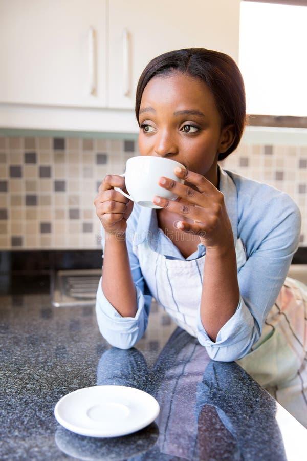 Housewife drinking coffee stock image