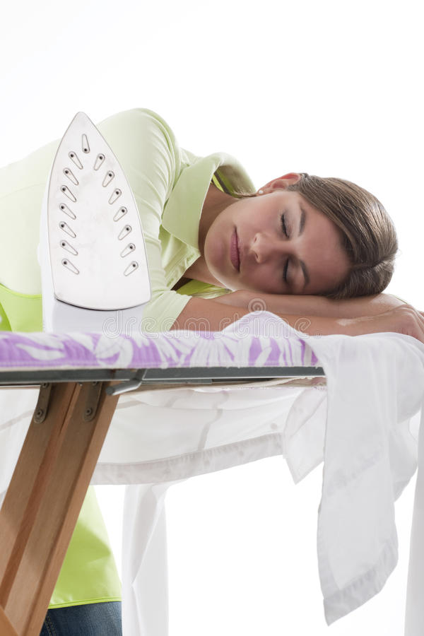 Housewife Fed Up Of Ironing. Young housewife fed up of ironing stock photos