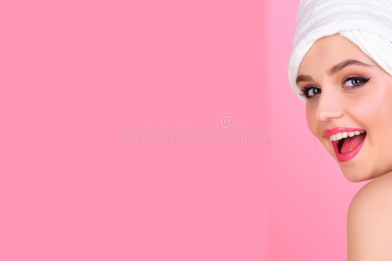 Housewife has makeup with towel or headscarf. Morning after bath washing and hair clean. Girl with fashionable turban on royalty free stock photography