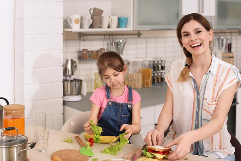 Housewife with her daughter preparing dinner royalty free stock photo