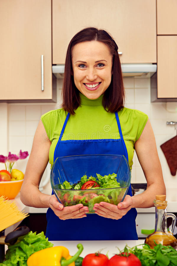 Download Housewife Holding Bowl Of Fresh Vegetable Salad Stock Image - Image: 29544023