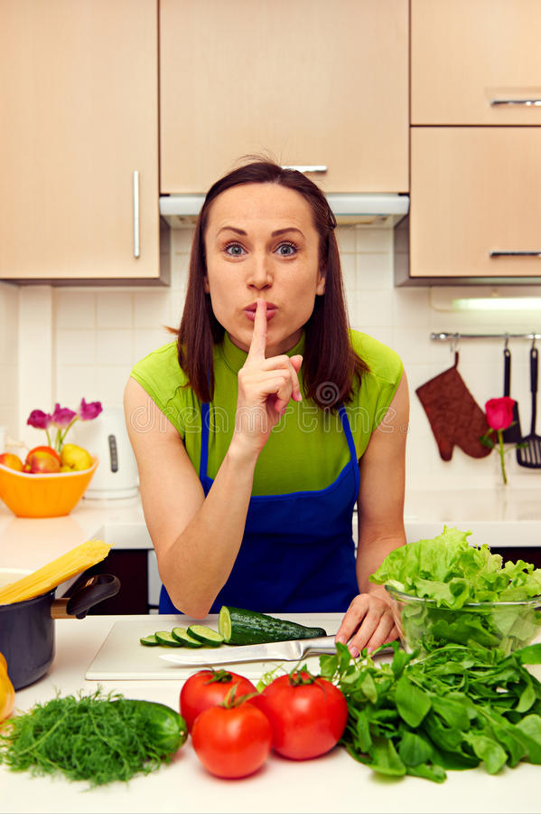 Housewife Holding Finger On Her Lips Stock Image