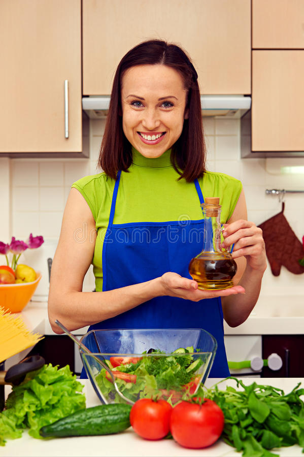 Housewife holding olive oil