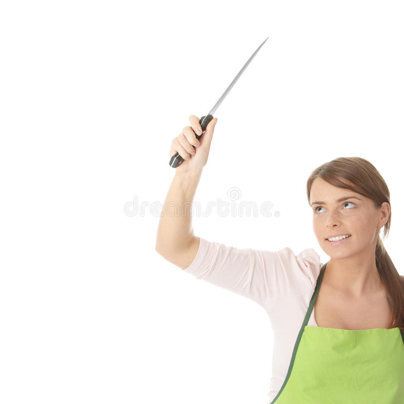 Housewife with knife. (cutting in air) isolated on white background stock image